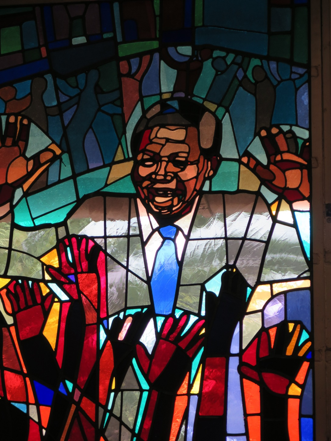 Stained Glass window in Soweto church depicting Nelson Mandela.