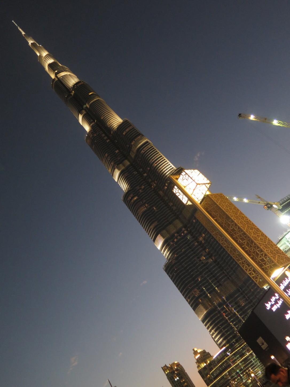 Burj Khalifa Dubai lit up at night, world's tallest building.