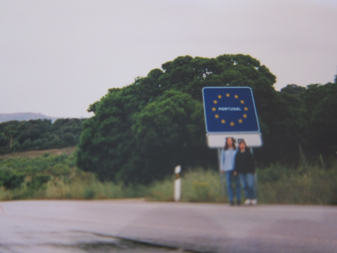 expat vs backpacker two women standing at the Portuguese border