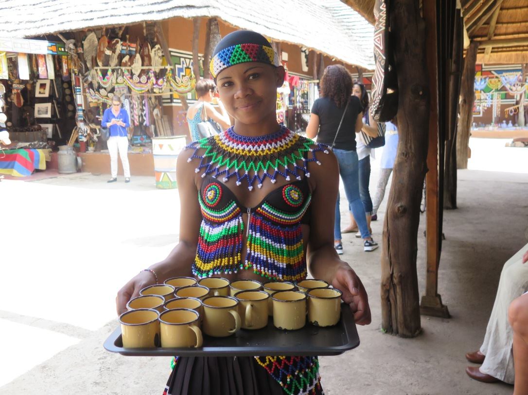 woman in tradtional beaded dress at lesedi cultural village south africa