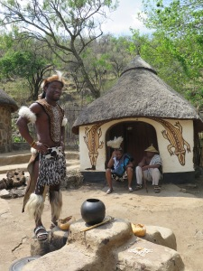 Our Zulu guide introduces the Sotho village.