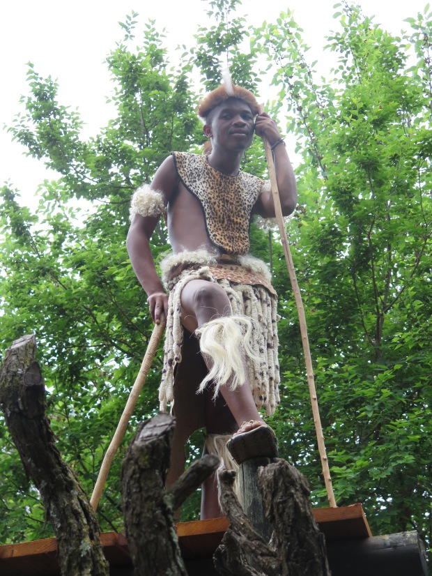 Lesedi cultural village a zulu warrior stands guard above his village