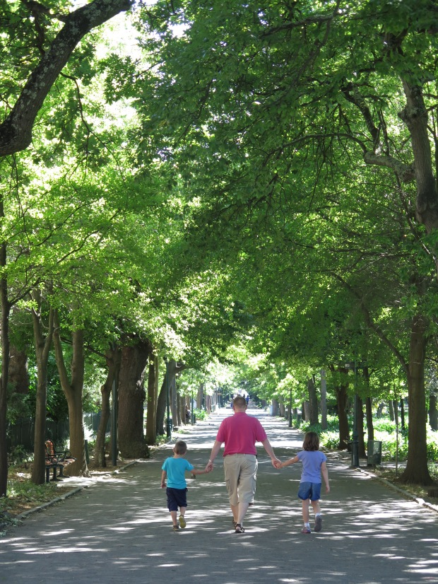 man and two children walking in Company's Garden