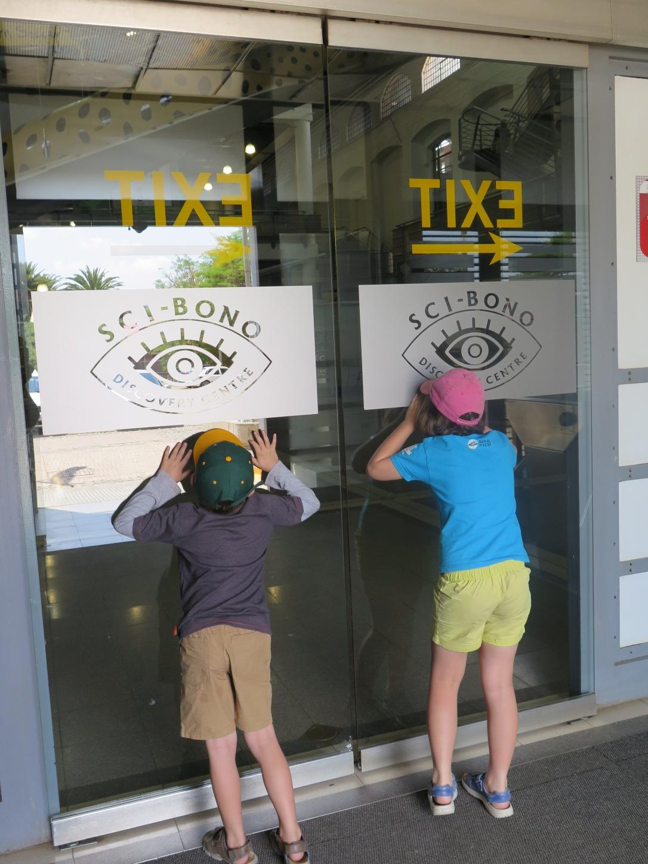 Children Peering through the glass doors at Sci Bono Discover Centre Johannesburg