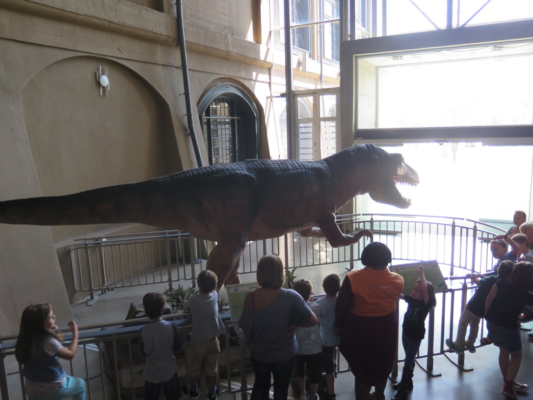 Group of children looking at electronic roaring dinosaur at Sci Bono Discovery Centre Johannesburg
