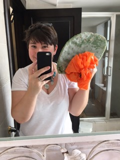 expat life is like fishing a cactus from the wheelie bin, woman holding giant cactus leaf