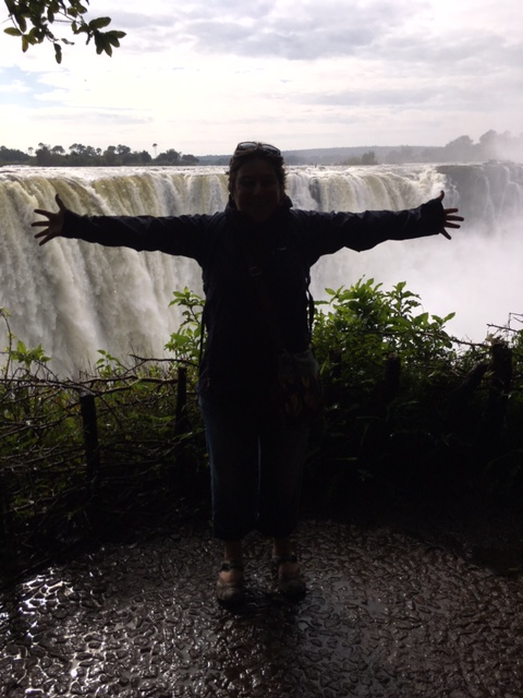 Arms Outstretched in front of Victoria Falls, Zimbabwe