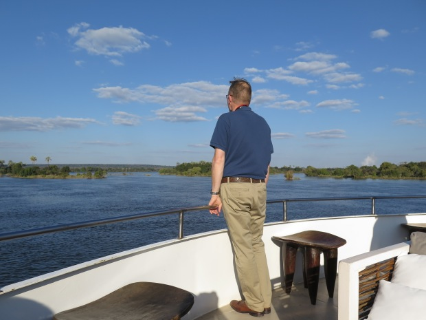Man on boat watching Sunset Cruise on the upper Zambezi