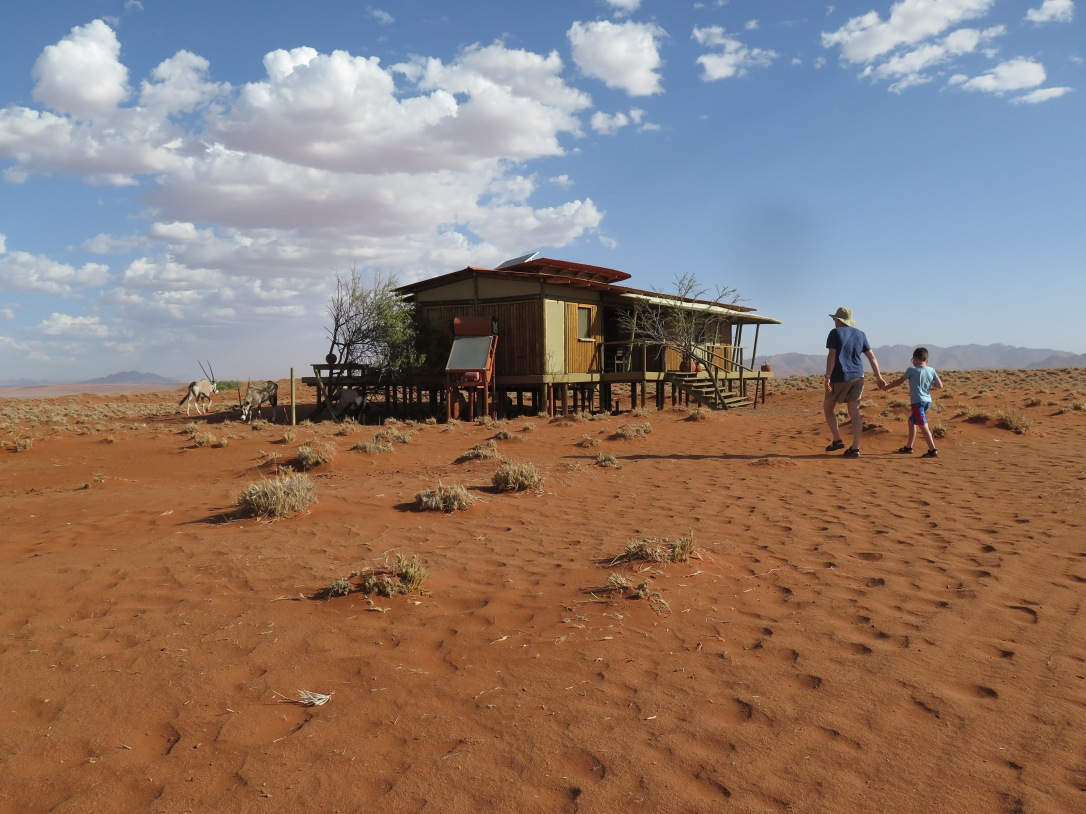 Wolvedans Namibia father and sun walking to stilt accommodation on a family road tripl