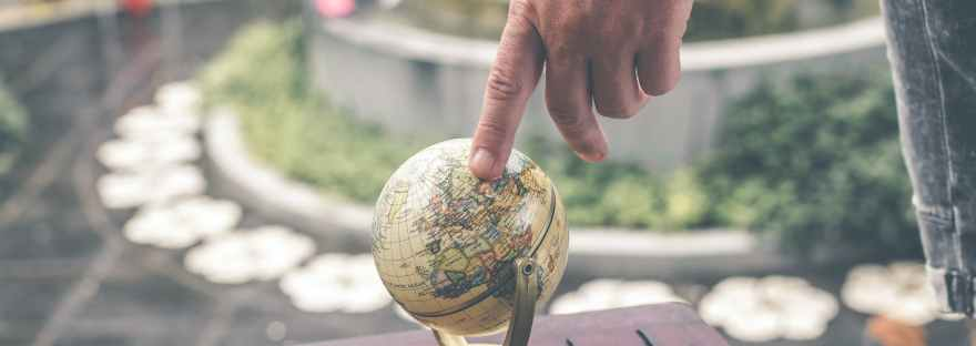 hand pointing to globe