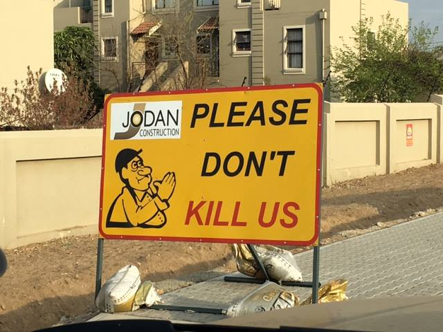 Road sign in Johannesburg South Africa saying please don't kill us