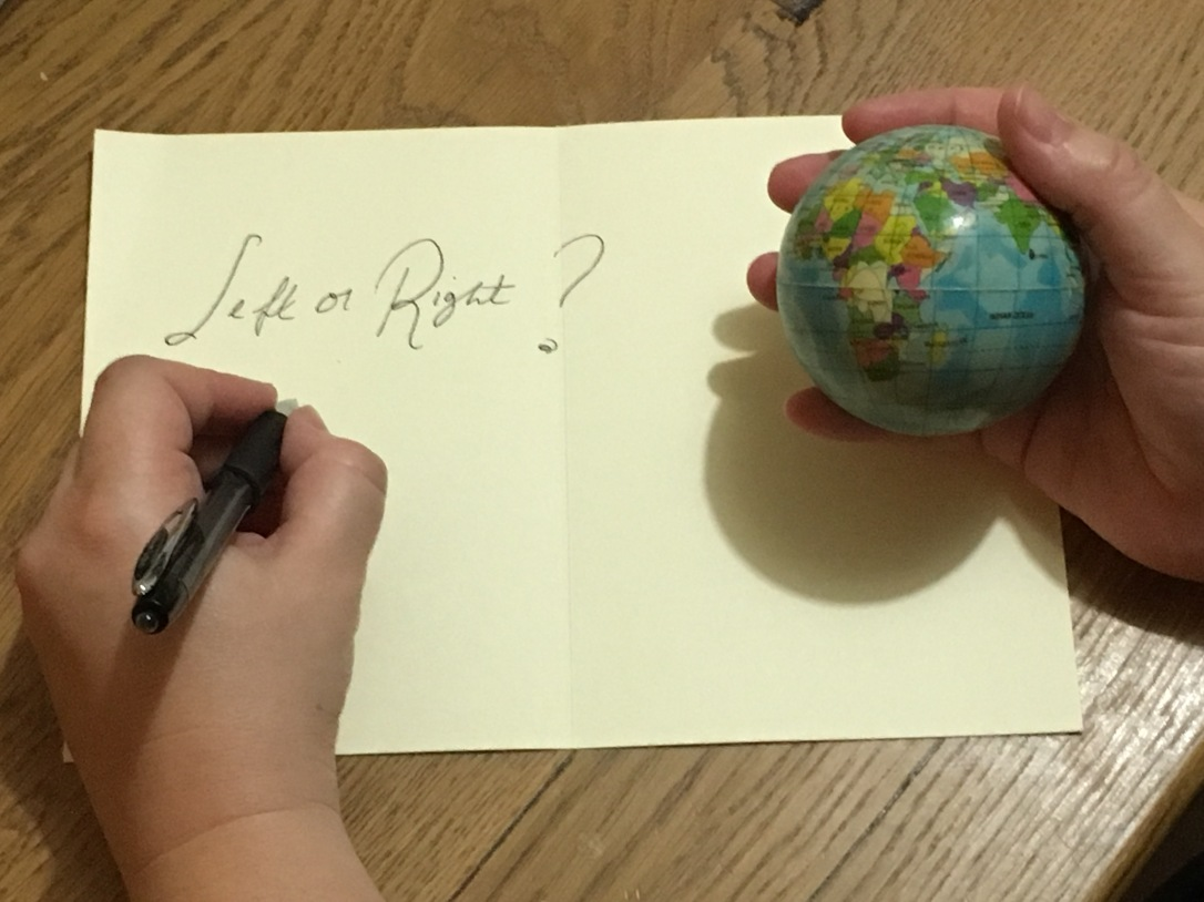 Being left handed in a right handed world, pen in left hand, globe ball in right hand.